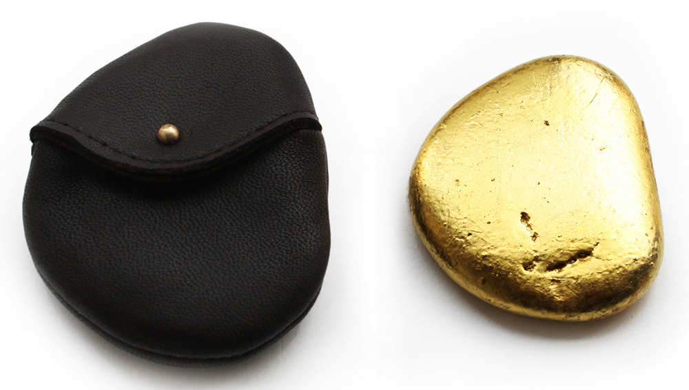 Luxury skimming stone with belt pouch by Dominic Wilcox. A luxury? Who needs it. Definitely in the non-essential category.